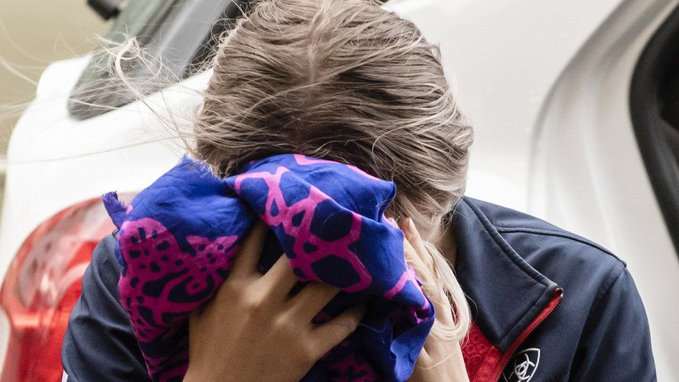 The woman covered her face as she arrived to hear the verdict