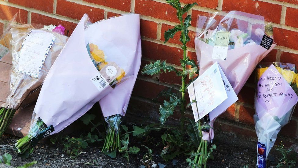 Floral tributes left outside Aylesbury house