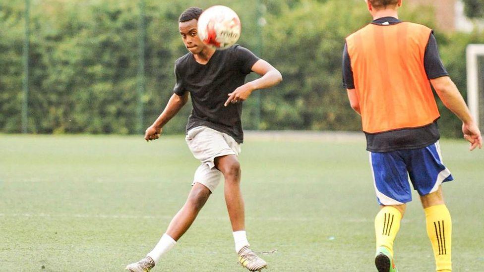 Omar Dirow playing football