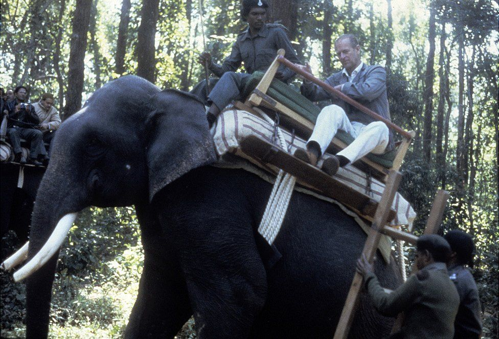 Prince Philip, Duke of Edinburgh rides an elephant during a visit to the Kanha game reserve on 21 November1983 in in India.