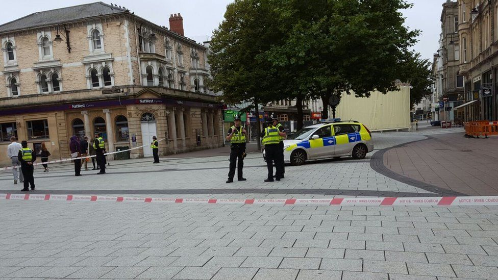 Police officers and vehicles on Cardiff's Queen Street
