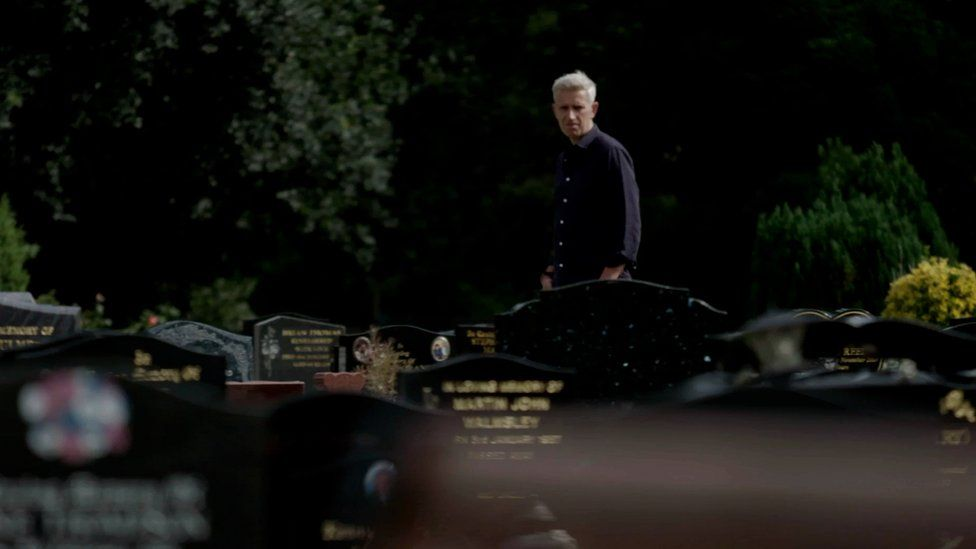 Reporter Richard Bilton walking through a graveyard in Stockton.