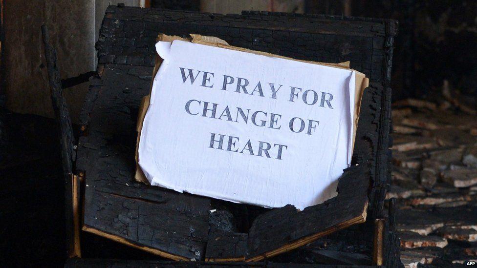 """Sign in St Sebastian's Church reading """"We pray for change of heart"""""""