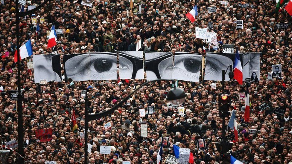 Demonstrators make their way along Boulevard Voltaire in a unity rally in Paris following the the attacks on 11 January 2015