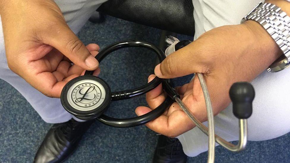 Dr Yemane holding a stethoscope