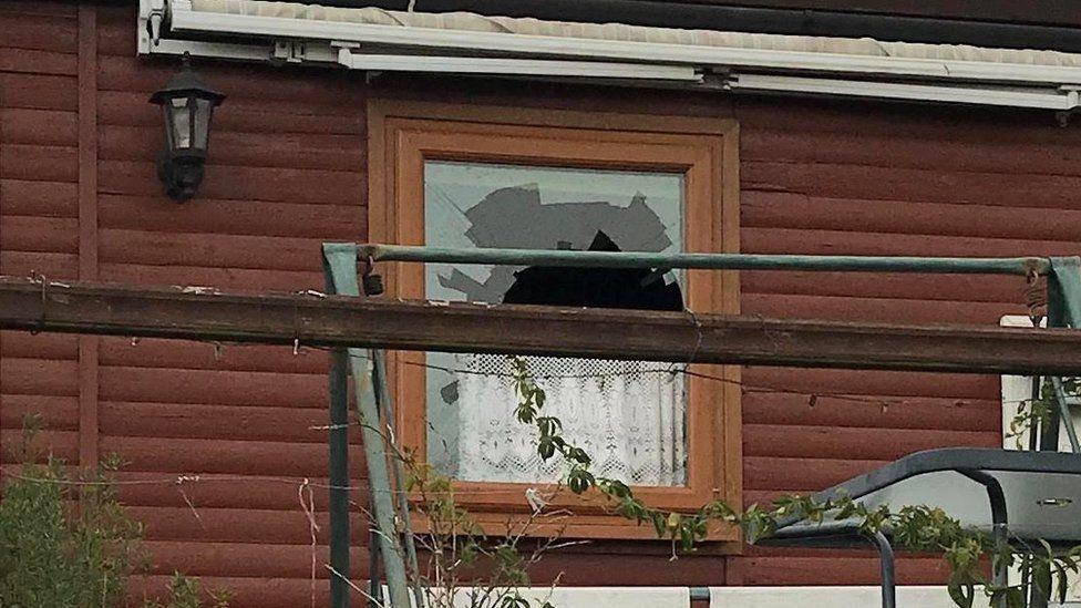 Smashed bathroom window in chalet
