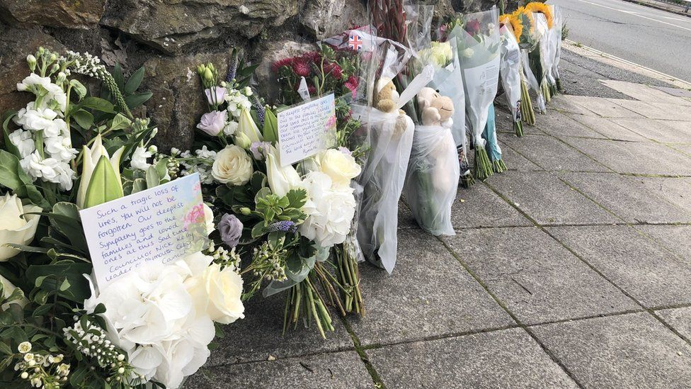 Floral and soft toy tributes were left on Wolesley Road, near Biddick Drive