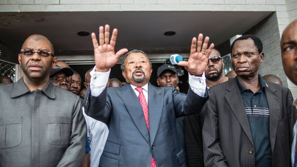 Jean ping outside his party headquarters