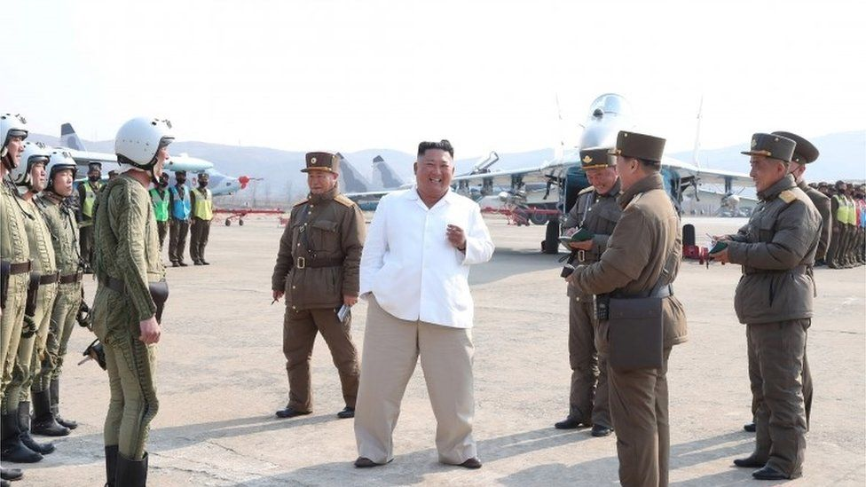 "North Korean leader Kim Jong Un gives field guidance during his visit to a pursuit assault plane group under the Air and Anti-Aircraft Division in the western area in this undated image released by North Korea""s Korean Central News Agency (KCNA) in Pyongyang on April 12, 2020."