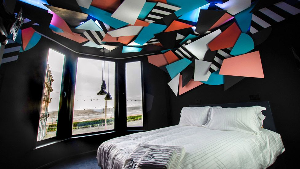 A light installation on the ceiling of artist Mark McClure's room brings the Blackpool illuminations indoors