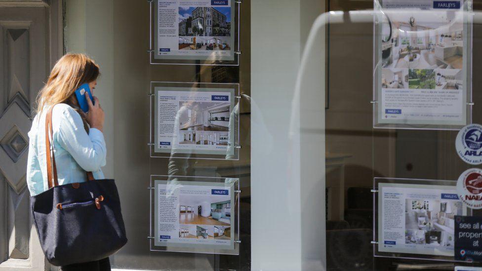 Women looking at estate agent window