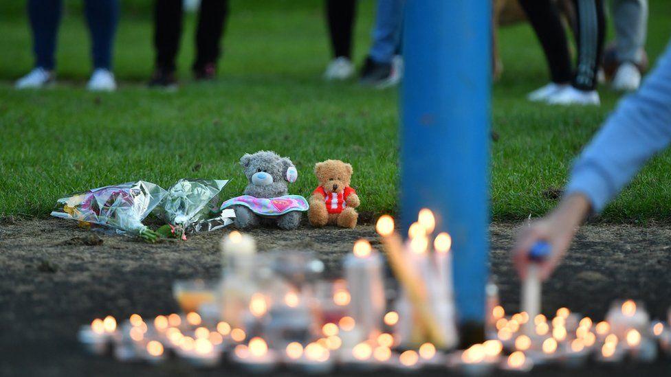candles lit at vigil
