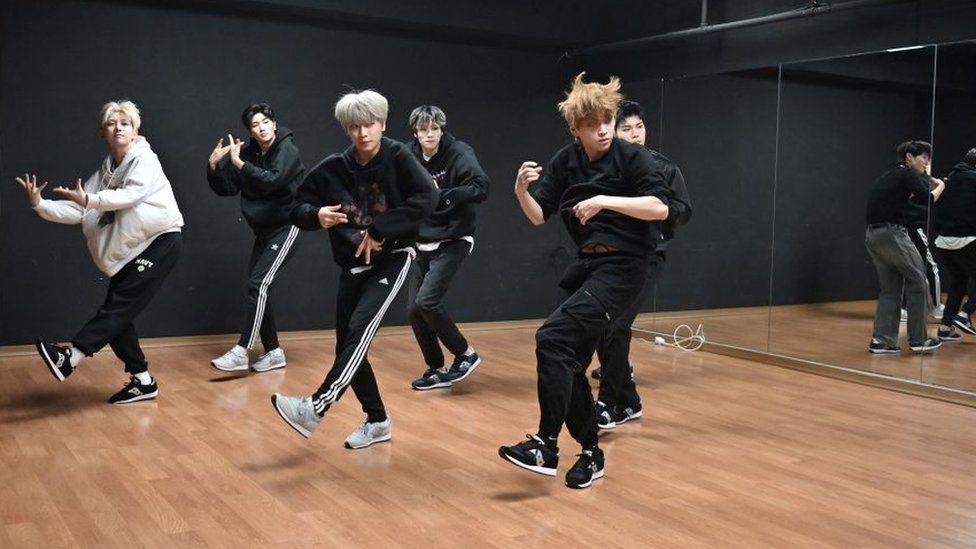 A K-pop group practice in a dance studio in Seoul