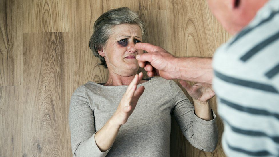 Woman being abused (generic)
