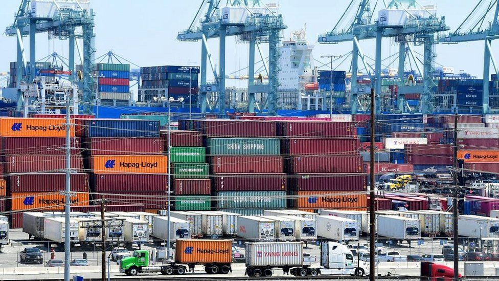 Container trucks arrive at the Port of Long Beach on August 23, 2019 in Long Beach, California