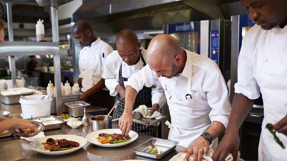 Chefs at work in kitchen