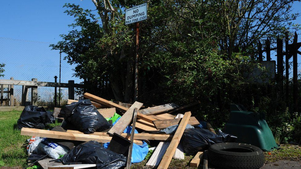 Rubbish dumped under a no dumping sign