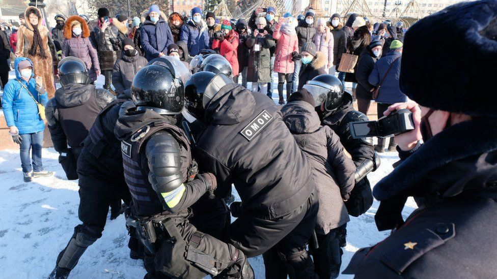 Riot police officers detain a participant in an unauthorised rally in support of Russian opposition activist Alexei Navalny in Khabarovsk