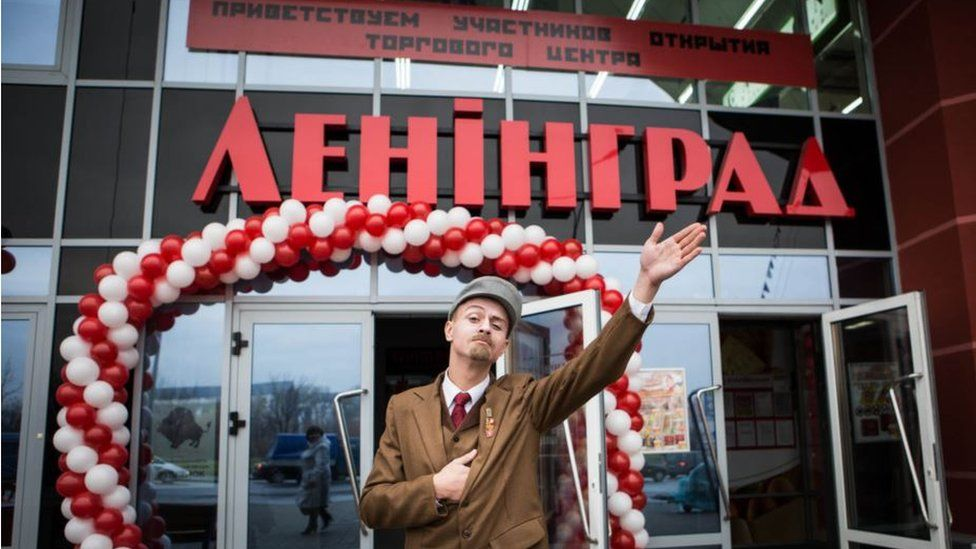 An actor dressed as a young Vladimir Lenin outside the Leningrad centre