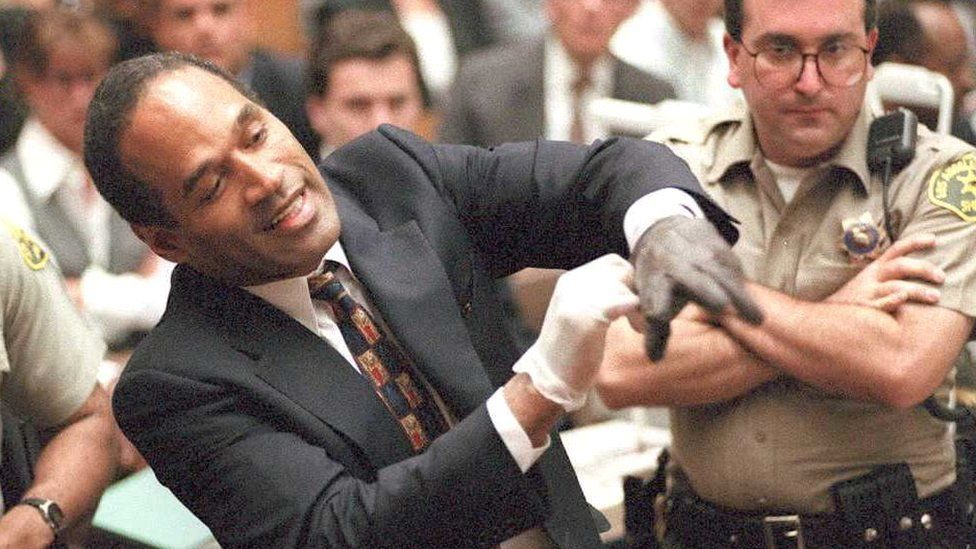 OJ Simpson tries on glove in front of jury at his trial