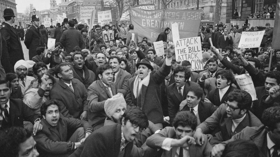 Protesters at a rally against the 1971 Immigration Act
