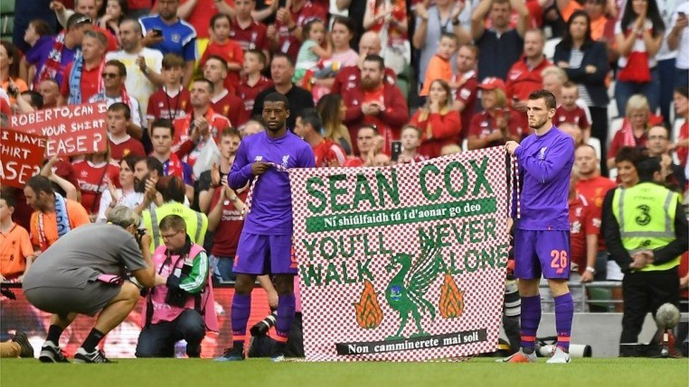 """Pre Season Friendly - Napoli v Liverpool - Aviva Stadium, Dublin, Ireland - August 4, 2018 Liverpool""""s Georginio Wijnaldum and Andrew Robertson hold up a banner in support of Liverpool fan Sean Cox after the match"""