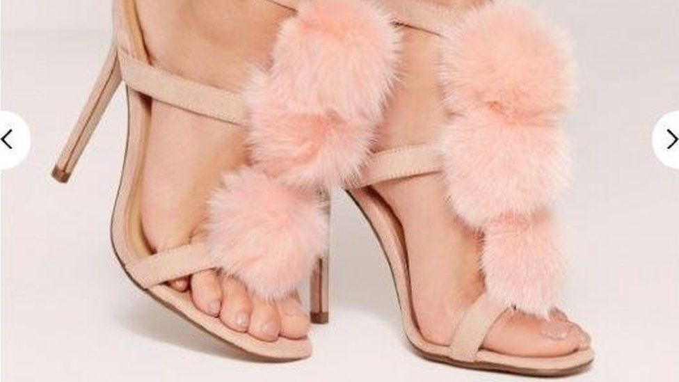 These shoes have cat fur pom poms