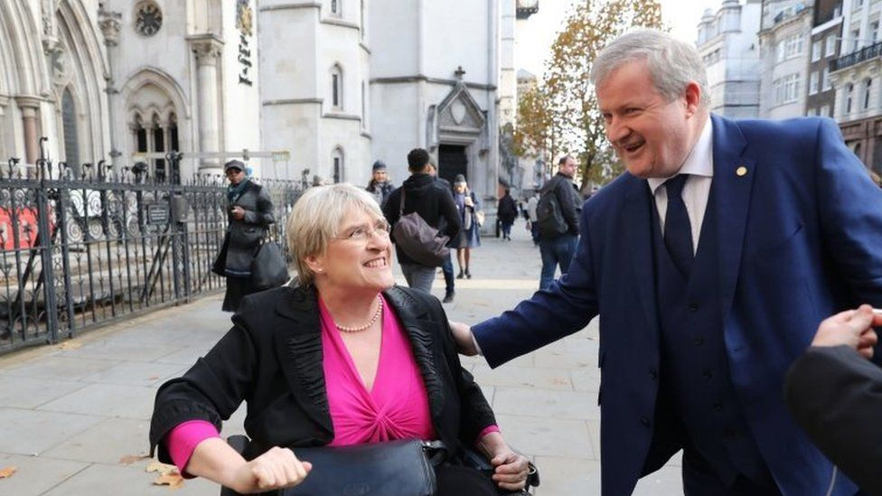 Liberal Democrat president Sal Brinton and SNP Westminster leader Ian Blackford outside London's High Court