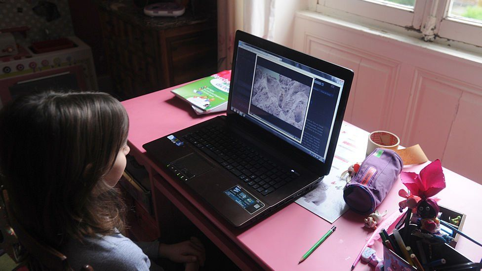 Child looking at computer screen