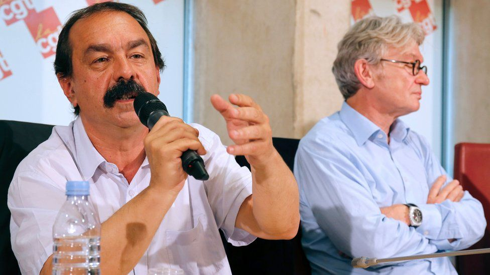 Secretary-general of the French General Confederation of Labour (CGT), Philippe Martinez (L), flanked by Secretary-general of the French workers' union Force Ouvriere (FO), Jean-Claude Mailly (R), speaks to journalists during a press conference on 22 June 2016 in Paris