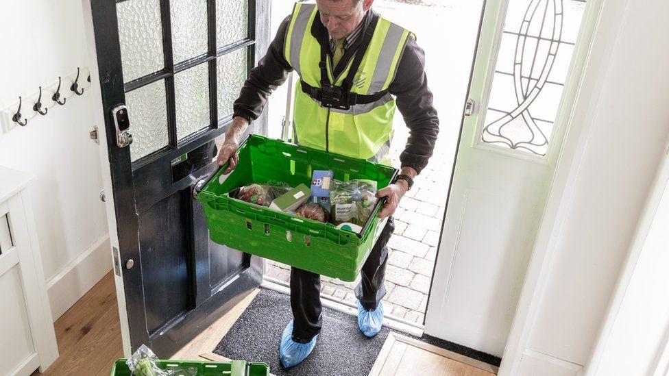 Waitrose delivery man at door