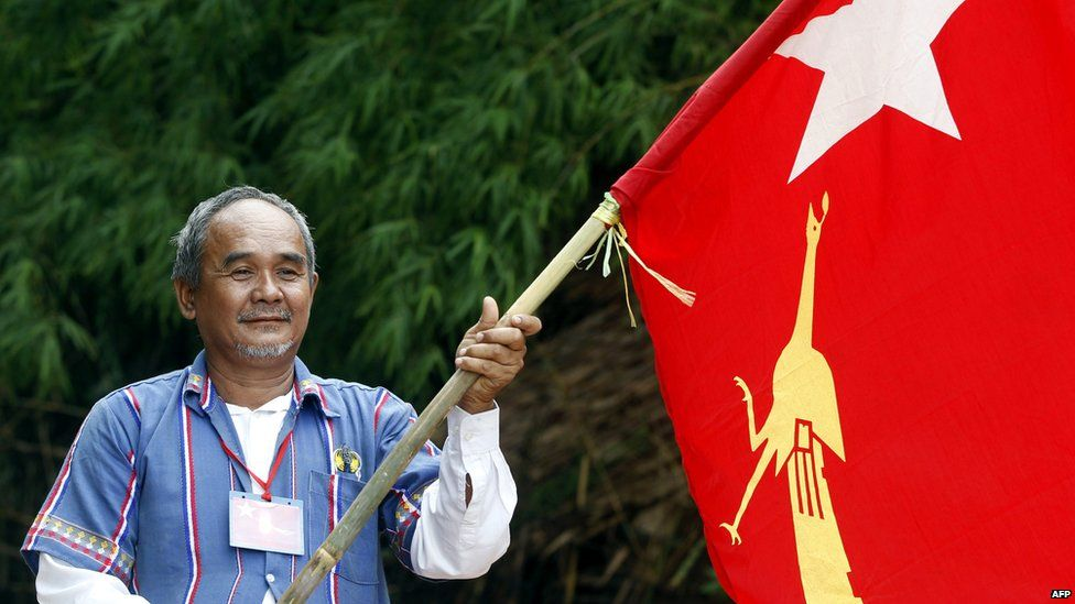 A man holds the flag of National League for Democracy (NLD) party in Kawmhu township, Yangon, Myanmar, 04 July 2015