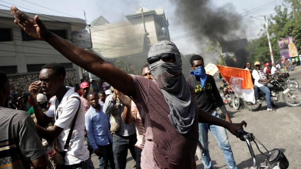 A demonstrator gestures during a protest to demand the resignation of Haitian president Jovenel Moïse, in Port-au-Prince, Haiti October 11, 2019