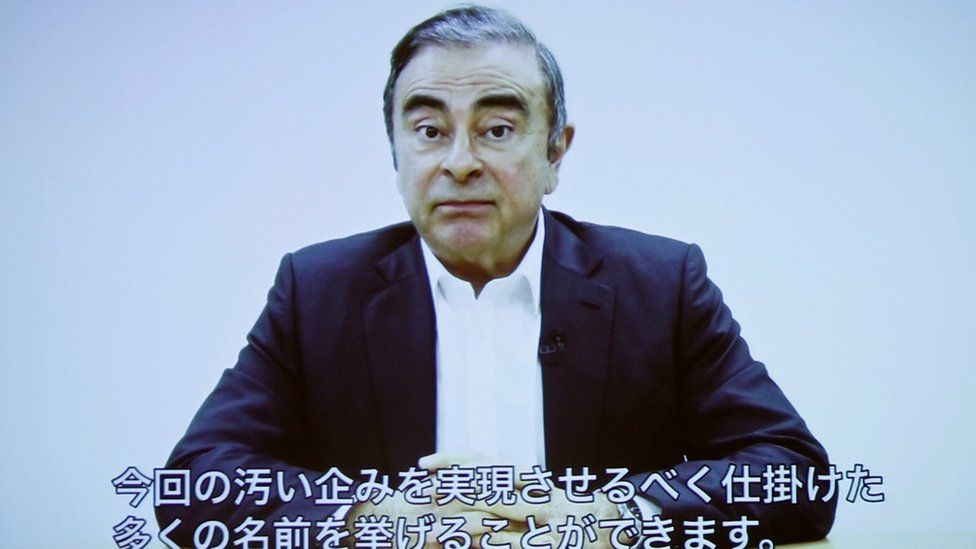 Carlos Ghosn delivering a video statement with Japanese captions in April 2019