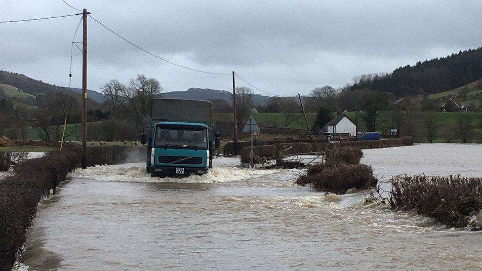 lorry driving through floodwater