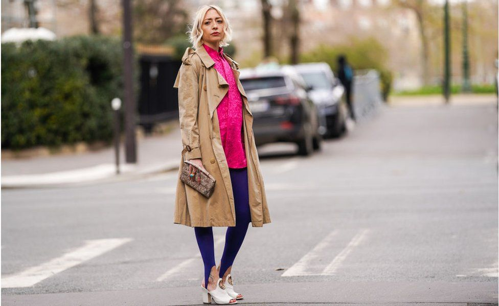 Model wearing a Burberry trench coat