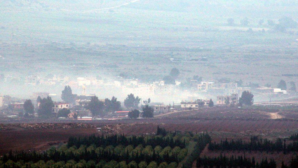 Smoke billows from buildings in the Wazzani river area on the Lebanese-Israeli borders following Israeli artillery fire (4 January 2016)