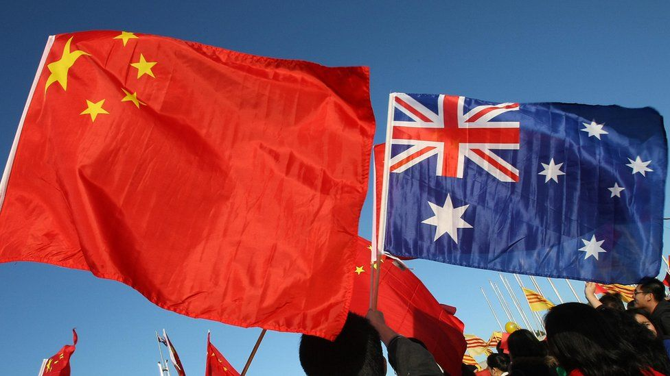 The Chinese and Australian flags flown by protesters in Canberra