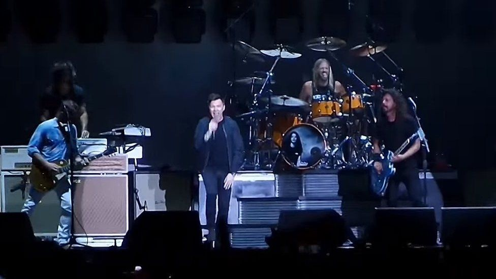Rick Astley on stage with Foo Fighters