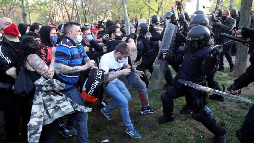 Spanish National Police members clash with protesters during Vox's regional election kick-off campaign rally in Vallecas, Madrid, Spain, 07 April 2021