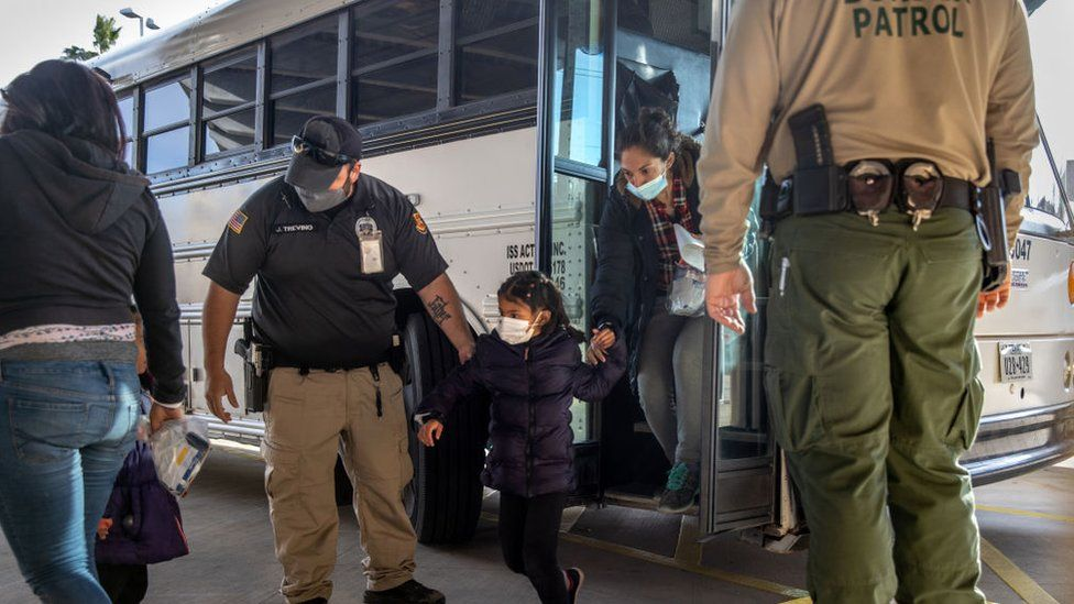 US immigration officers release asylum seekers at a bus station on February 25, 2021 in Brownsville, Texas