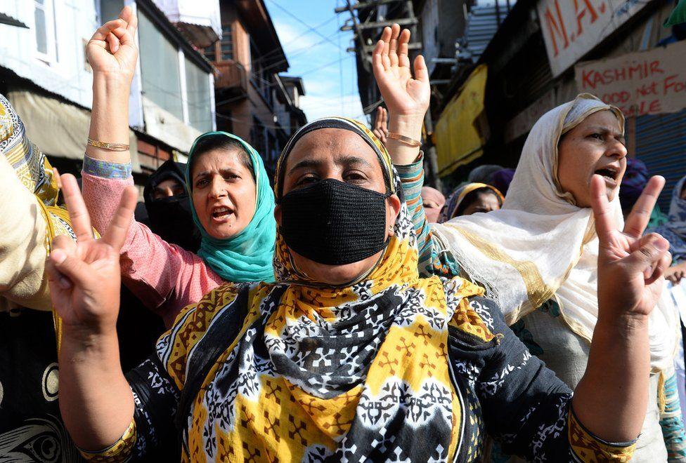 Kashmiri muslims shout anti-India slogans during a protest in Srinagar on August 26, 2016.