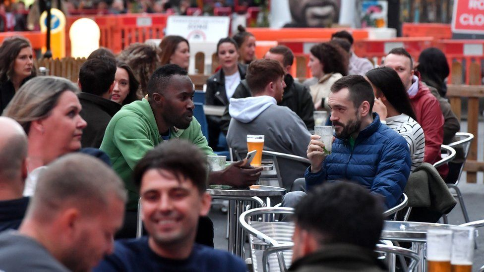 Bars on Hilton Street in Manchester's Northern Quarter set out tables for customers