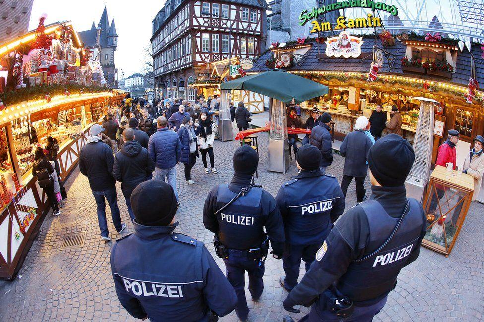 German police officers patrol the Christmas market in Frankfurt, 20 December