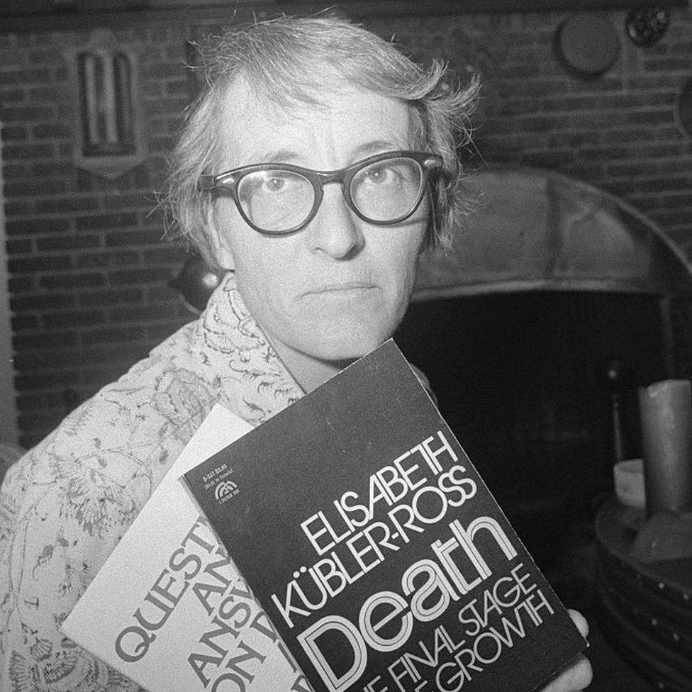 Elisabeth Kübler-Ross holding two of her books