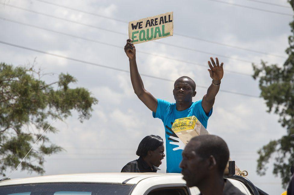 Dickson Juma marches in a deaf awareness march in Kapsabet, Kenya