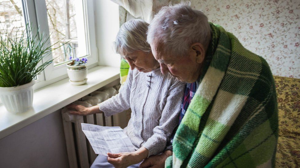 Elderly couple look at heating bill