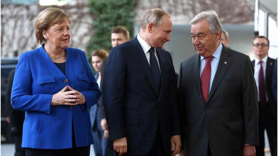 German Chancellor Angela Merkel, Russian President Vladimir Putin and United Nations Secretary-General Antonio Guterres arrive for an international summit on securing peace in Libya, held in Germany