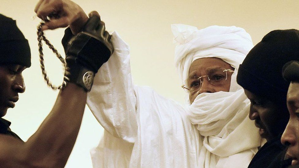 Former Chadian dictator Hissene Habre (C) is escorted by prison guards into the courtroom for the first proceedings of his trial by the Extraordinary African Chambers in Dakar on July 20, 2015.
