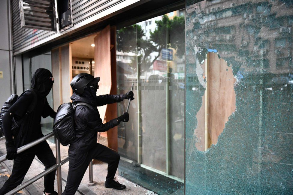 Protesters vandalise the Cheung Sha Wan local government offices during a demonstration in Hong Kong on October 6, 2019